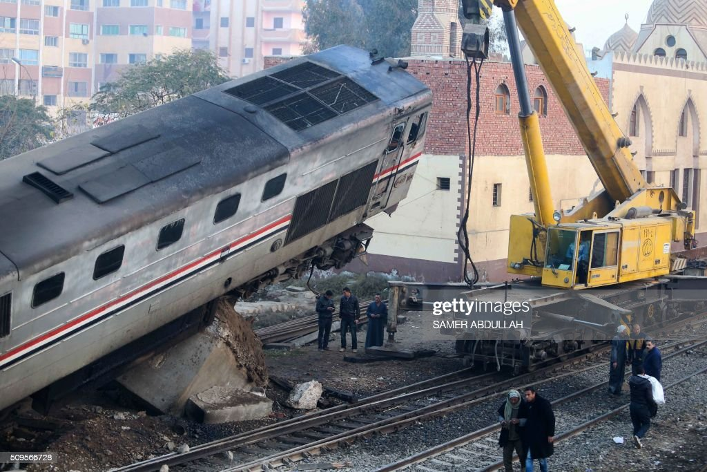 A general view shows the site where a train crashed near Beni Suef some 180 kilometres, south of the capital Cairo, on February 11, 2016. At least 70 people were injured in Egypt when a passenger train derailed and two of its cars overturned, the health ministry said. ABDULLAH