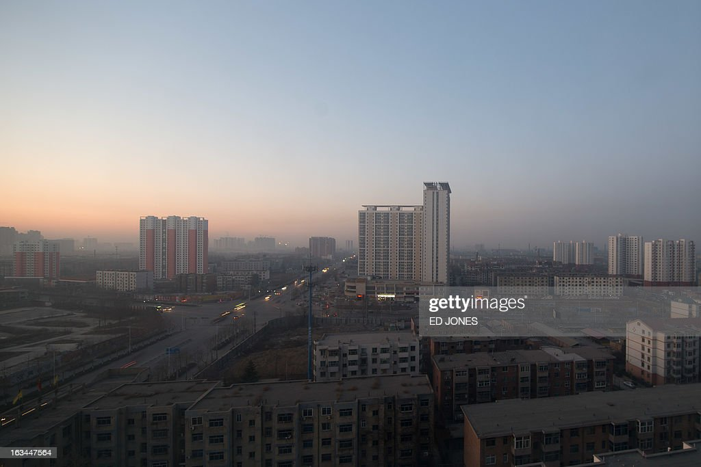 A general view shows the skyline of Baoding, Hebei province, some 140 km south of Beijing early on March 10, 2013. Chinese inflation hit a 10-month high in February while growth in industrial production and retail sales slowed, official data showed, complicating policymakers' efforts to boost recovery. AFP PHOTO / Ed Jones