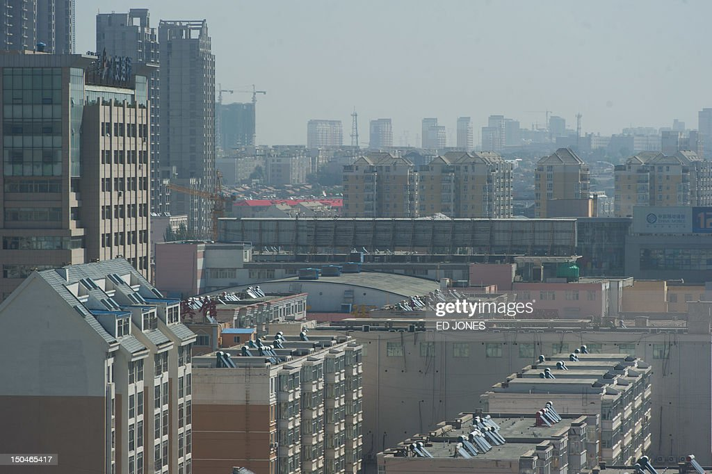 A general view shows the skyline of the Dongsheng district of the inner Mongolian city of Ordos on August 19, 2012. Miss China won the coveted title of Miss World on August 18, triumphing on home soil during a glitzy final held in a mining city on the edge of the Gobi desert. The city has grown rich over the past decade on the back of a coal mining boom that has transformed it from a sandstorm-afflicted backwater into one of the wealthiest places in China. The boom triggered a frenzy of building in the city, but the local government has struggled to fill the vast tower blocks that sprung up, earning it the title of China's biggest ghost town. AFP PHOTO / Ed Jones