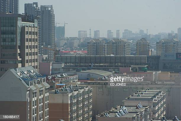 A general view shows the skyline of the Dongsheng district of the inner Mongolian city of Ordos on August 19 2012 Miss China won the coveted title of...