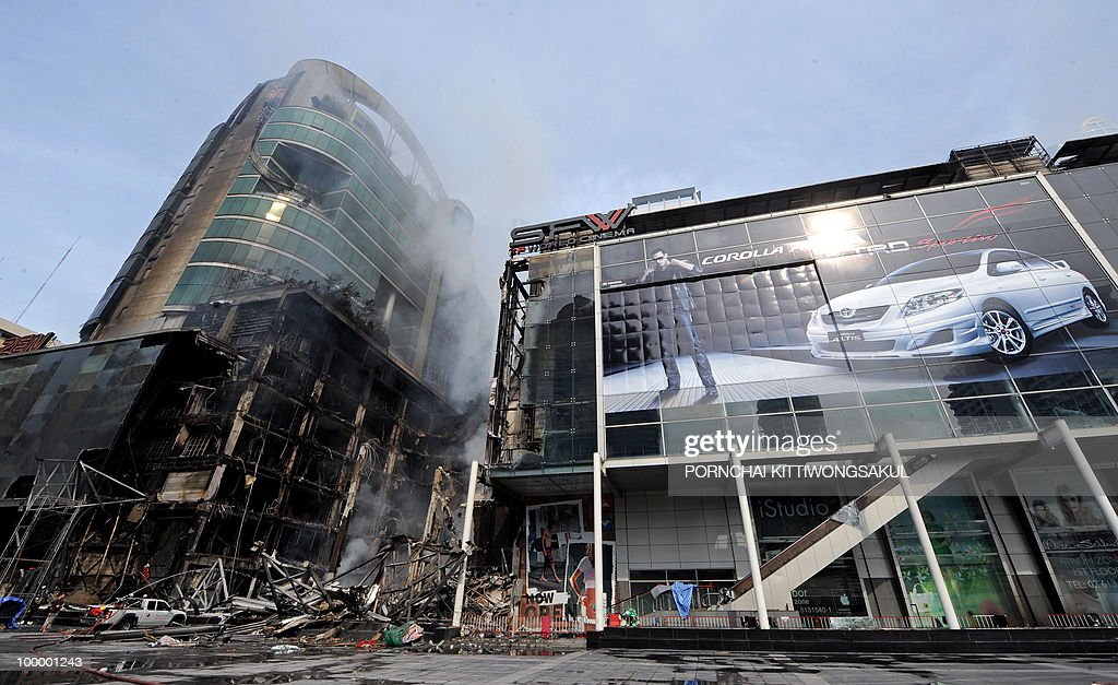 A general view shows the smouldering remains of Thailand's biggest shopping mall - Central World - after it was set ablaze the day before following an army assault on an anti-government protest site in downtown Bangkok on May 20, 2010. Thailand's biggest shopping mall faces collapse after it was set ablaze by enraged protesters in the wake of an army offensive to shut down an anti-government rally, police said.