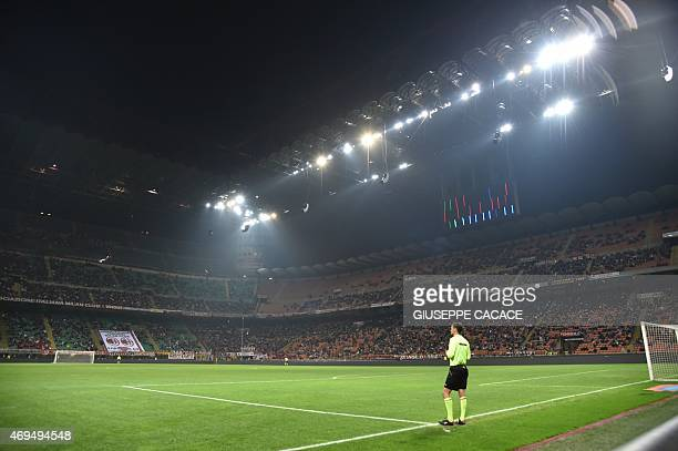 A general view shows the stadium during a partial blackout at the Italian Serie A football match between AC Milan and Sampdoria at San Siro Stadium...
