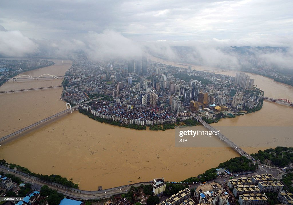 TOPSHOT A general view shows the swollen Liujiang River in Liuzhou south China's Guangxi Zhuang Autonomous Region on July 5 2016 Flooding in China's...