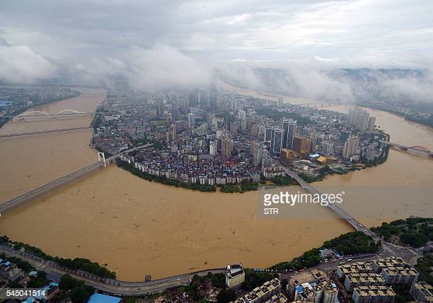 TOPSHOT A general view shows the swollen Liujiang River in Liuzhou south China's Guangxi Zhuang Autonomous Region on July 5 2016 Flooding in China's...