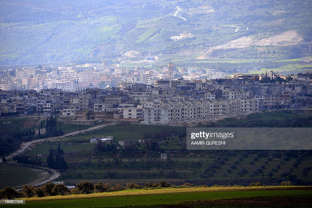 A general view shows the Syrian city of Jisr al-Shughur under the control of pro-regime troops, near the border with Turkey, on February 2, 2013. After the retreat of Syrian government forces from the town of al-Janudia, the rebels have taken control of the surrounding north, east and western hills overlooking Jisr al-Shughour, which is located in a valley that is still in the hands of regime troops protecting the Alawite villages, loyal to Syrian President Bashar al-Assad to the south. AFP PHOTO/AAMIR QURESHI
