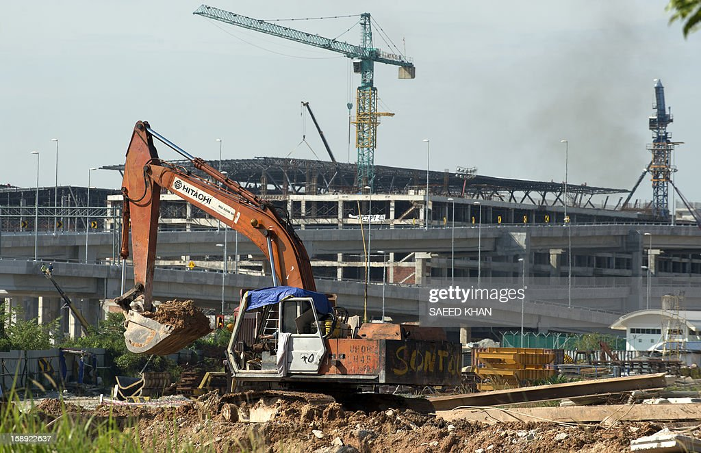 A general view shows the under construction site of new low-cost airport, Kuala Lumpur International Airport 2 (KLIA2), in Sepang on January 4, 2013. KLIA2 is envisaged to handle a maximum of 45 million passenger a year. and has 60 gates, eight remote stands, 80 aerobridges, plus a retail space of 32,000 square metres to accommodate 225 retail outlets. AFP PHOTO / Saeed Khan