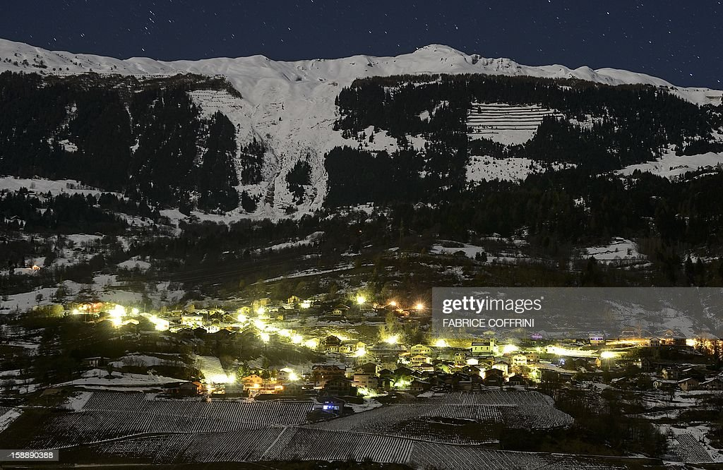 A general view shows the village of Daillon early on January 3, 2013 after it was closed to the press following a shooting. A gunman has opened fire in a village in southern Switzerland, killing three people and wounding two others, police said on January 3.