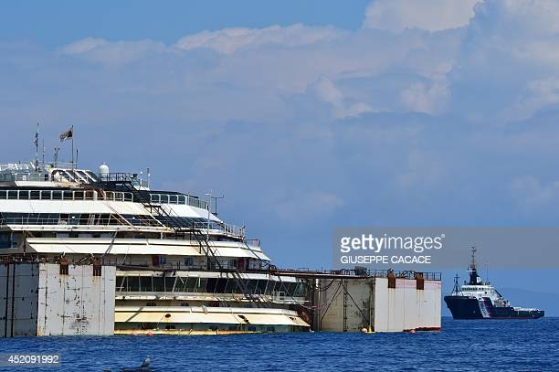 A general view shows the wrecked Costa Concordia cruise ship that lays off the Giglio island on July 13 2014 Italian authorities gave today their...