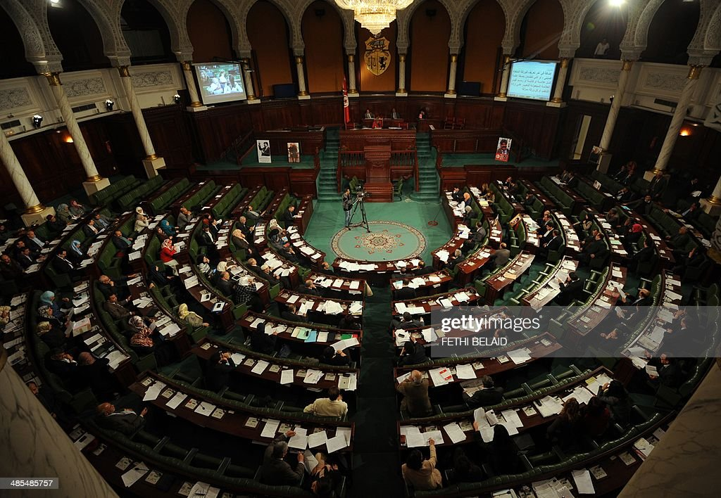 A general view shows Tunisian National Constituent Assembly deputies attending a parliament session to debate Tunisia's electoral law which will pave...