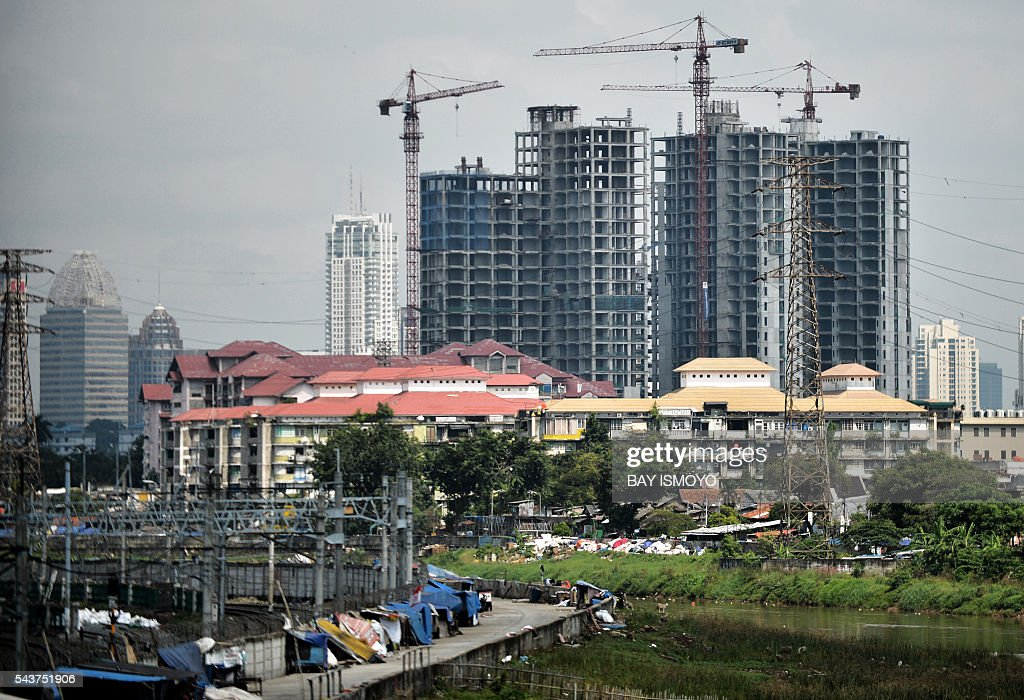 A general view shows under-construction buildings in Jakarta on June 30, 2016. Indonesia launched a tax amnesty in a bid to give Southeast Asias top economy a multibillion-dollar boost, defying criticism the move will let evaders off the hook. / AFP / BAY