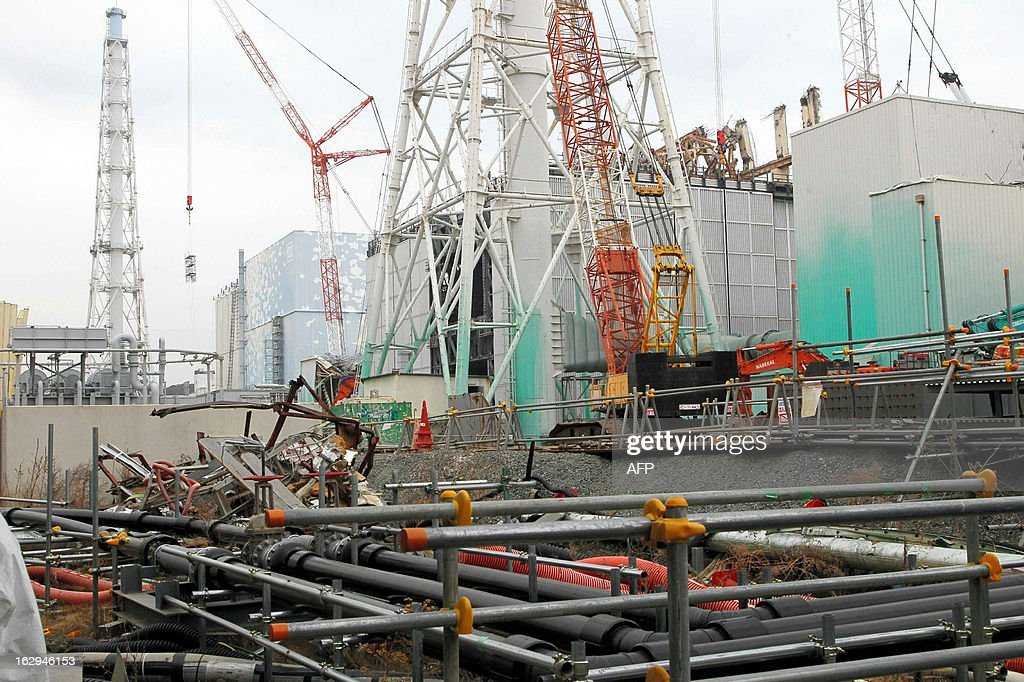 A general view shows unit three and unit two reactor building (light blue, L) of the Tokyo Electric Power Co (TEPCO) Fukushima Dai-Ichi nuclear power plant stands in Okuma Town, in Fukushima prefecture on March 1, 2013. TEPCO opened up its stricken Fukushima plant to journalists, ahead of the second anniversary of the March 11 disasters. AFP PHOTO / JAPAN POOL via JIJI PRESS JAPAN OUT