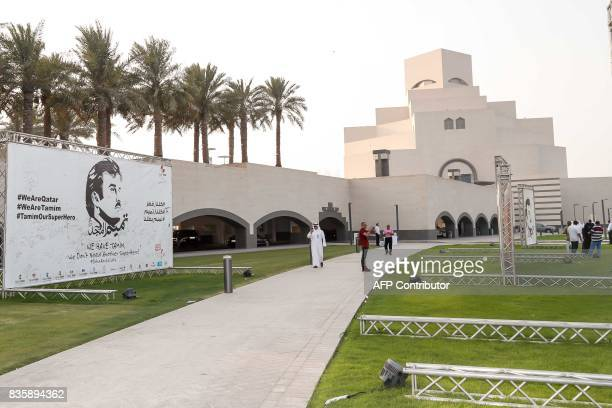 A general view shows visitors at an exhibition of artworks which were donated by members of the community depicting Qatari Emir Tamim bin Hamad...