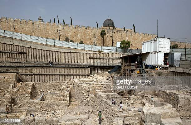 A general view shows workers from the Israeli Antiquity Authorities digging on November 3 2015 at the excavation site near the City of David adjacent...
