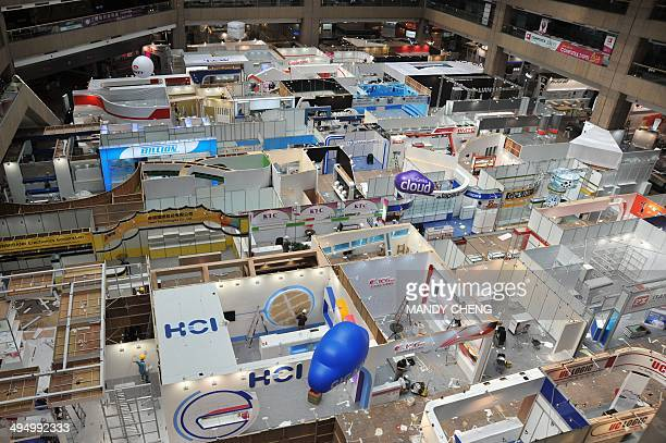 A general view shows workers putting the finishing touches to the booths at the Taipei World Trade Centre the venue of the annual Computex Asia's...
