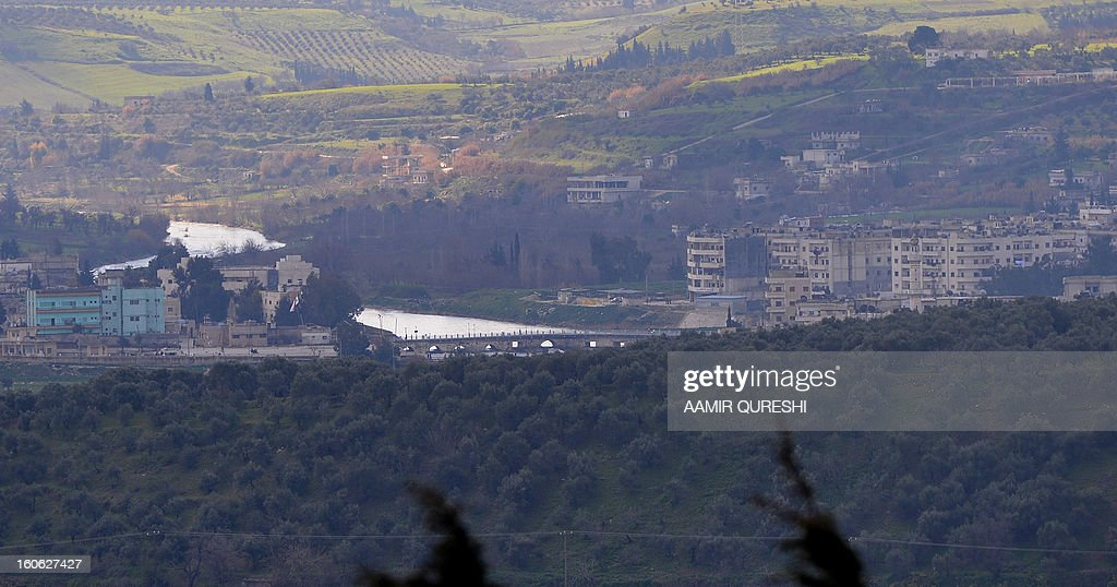 A general view showsview of the Roman bridge of Jisr al-Shughur, a northern Syrian city under the control of pro-regime troops near the border with Turkey, on February 2, 2013. After the retreat of Syrian government forces from the town of al-Janudia, the rebels have taken control of the surrounding north, east and western hills overlooking Jisr al-Shughour, which is located in a valley that is still in the hands of regime troops protecting the Alawite villages, loyal to Syrian President Bashar al-Assad to the south.