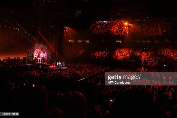 General view taken as Shakira and Chris Martin from Coldplay perform together on stage during the Global Citizen Festival G20 benefit concert at the...