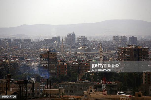 A general view taken from a rebel outpost shows the Ommayad Mosque in the alQaboun rebel held northeastern suburb of the capital Damascus on March 13...