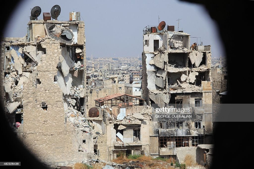 A general view taken from Aleppo's Syrian regime-controlled neighbourdhood of Karm al-Jabal shows heavily damaged buildings on July 30, 2015.