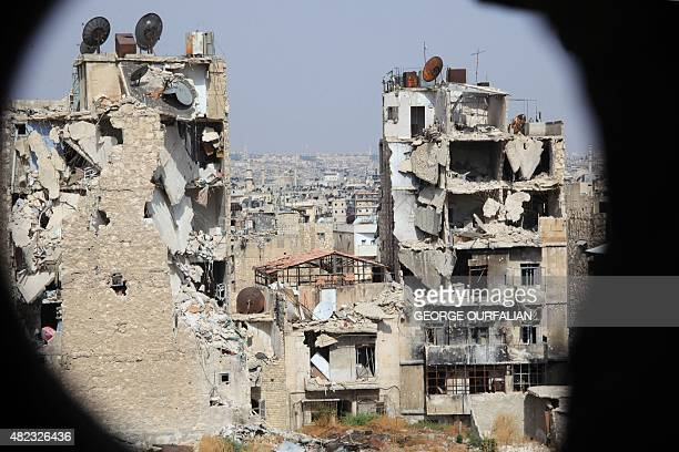 A general view taken from Aleppo's Syrian regimecontrolled neighbourdhood of Karm alJabal shows heavily damaged buildings on July 30 2015 AFP PHOTO /...
