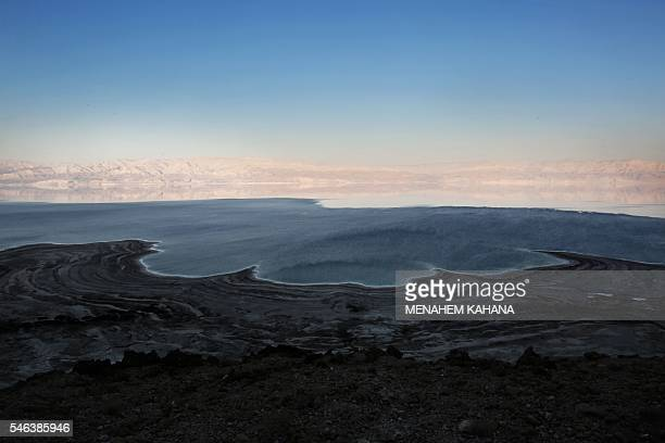 TOPSHOT A general view taken from Israel shows the Dead Sea with the Jordanian mountains in the background on July 11 2016 Experts have warned that...
