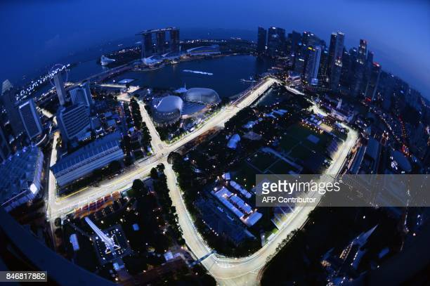 TOPSHOT A general view taken from Swissotel the Stamford shows the illuminated circuit for the upcoming Formula One Singapore Grand Prix night race...