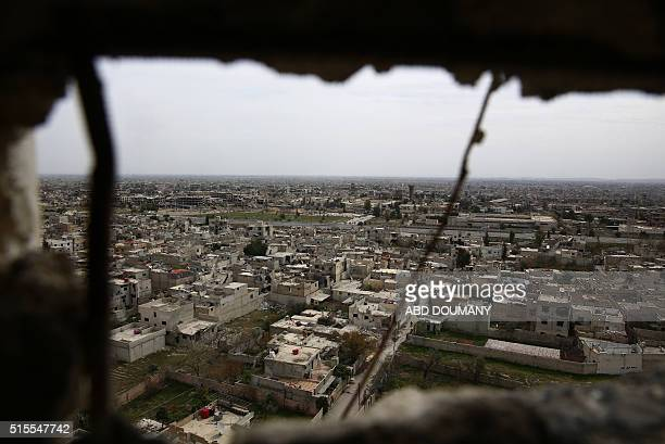 TOPSHOT A general view taken from the alQaboun rebel held northeastern suburb of the capital Damascus on March 13 2016 shows damaged buildings in the...