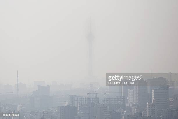 A general view taken from the north of Tehran shows the capital's telecommunication Milad tower which is barely visible due to the heavily polluted...