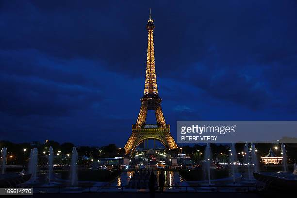 A general view taken late on May 28 2013 shows the Eiffel Tower before it was lit up with the colors of the South African flag to mark the official...
