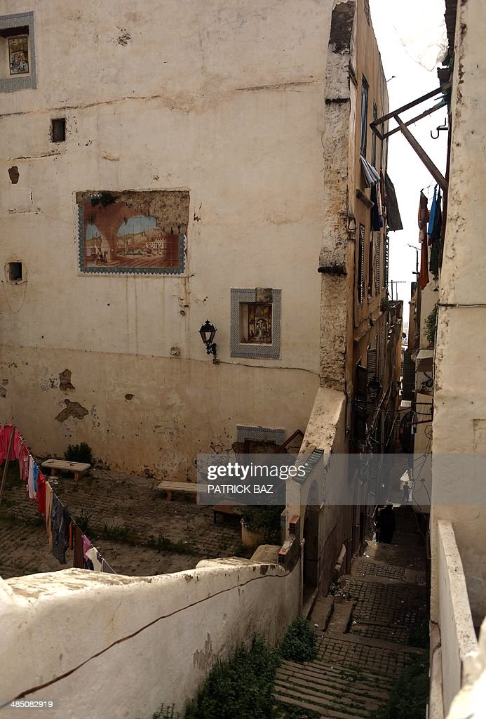 A general view taken on April 16, 2014 shows laundry hanging in the ancient ruins of a building in the old part of Algiers, known as the 'Kasbah'.