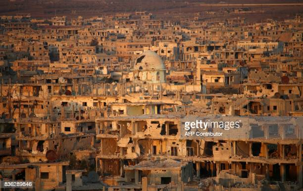 A general view taken on August 21 shows damaged and destroyed buildings in Syria's southern city of Daraa / AFP PHOTO / Mohamad ABAZEED