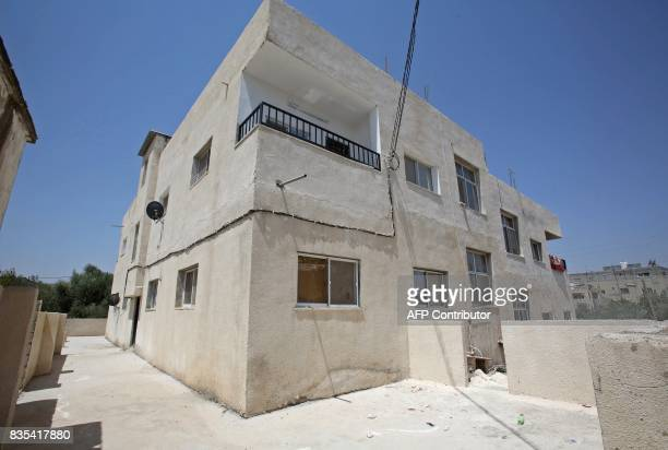 A general view taken on August 9 shows a building in the northern Jordanian town of Irbid where Syrian refugees are being housed under a programme...