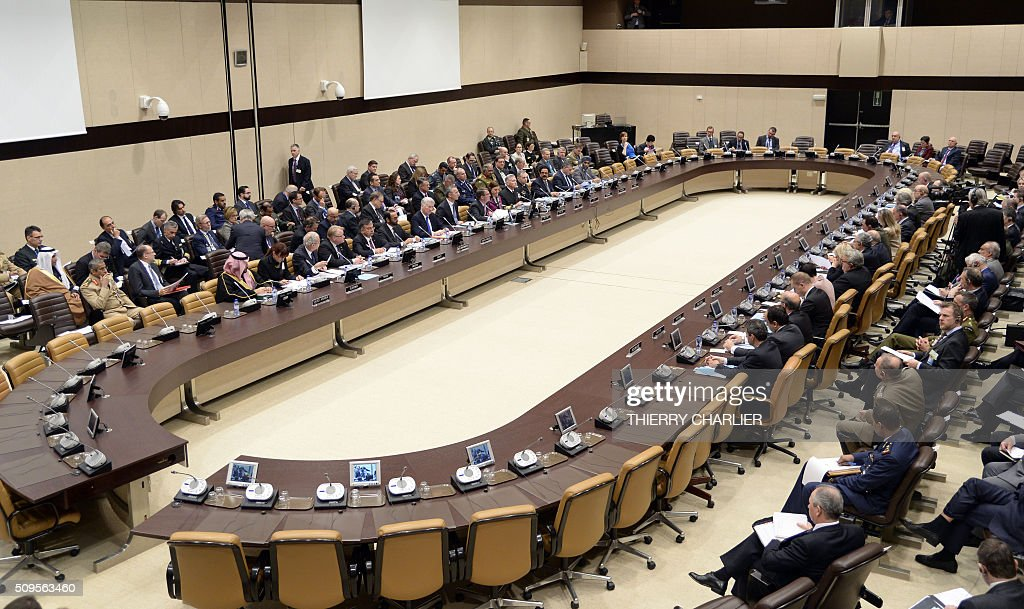 General view taken on Feberuary 11, 2016 shows the Global Coalition meeting held at NATO headquarters in Brussels. NATO launched an unprecedented naval mission in the Aegean Sea to tackle people smugglers taking migrants and refugees from the Turkish coast, Secretary General Jens Stoltenberg said on Thursday. / AFP / THIERRY CHARLIER