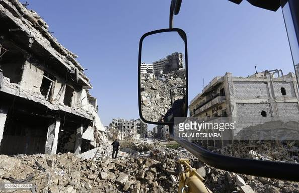 TOPSHOT A general view taken on January 22 2017 shows destroyed buildings in the old city of Aleppo a month after government forces retook the city...