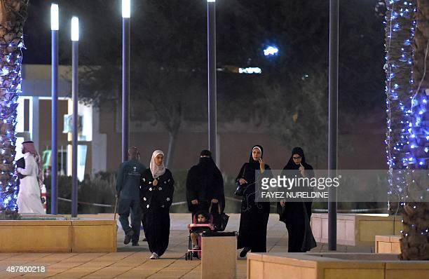 A general view taken on July 13 2015 shows Saudi women walking in the restored historical AlBureji area in the UNESCO World Heritage Atturaif...