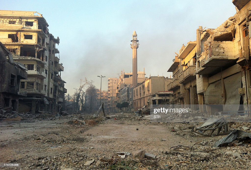 A general view taken on July 28, 2013 shows destruction in the Khalidiyah neighbourhood of Syria's central city of Homs. Government forces bolstered by Lebanese Shiite militiamen were poised to retake the largest rebel-held district of Syria's third city Homs, a watchdog and state media said. AFP PHOTO/STR