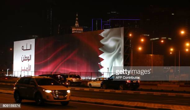 A general view taken on June 11 2017 shows a billboard bearing the Bahraini flag in Doha PHOTO / Karim JAAFAR