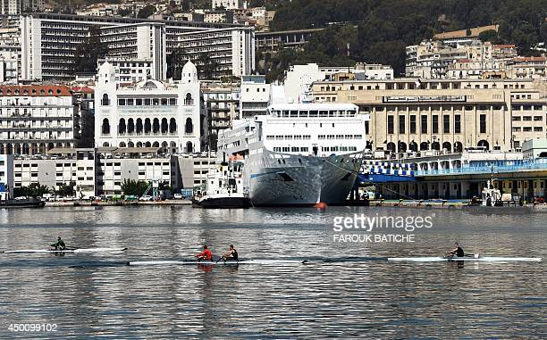 A general view taken on June 5 2014 shows people rowing in the Bay of Algiers with the old town of the Algerian capital known as the 'Kasbah' in the...