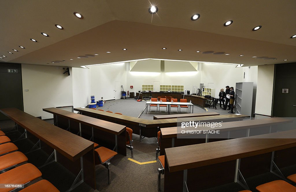 A general view taken on March 15, 2013 shows the courtroom at the Regional Court of Munich, southern Germany, where the trial against the sole survivor of the far-right militants NSU and four other alleged neo-Nazi accomplices will take place as of April 17, 2013. Beate Zschaepe of the NSU is suspected of involvement in 10 murders, including the killing of nine men of Turkish or Greek origin across Germany between 2000 and 2006 and a German policewoman in 2007, as well as 15 armed robberies, arson and attempted murder.