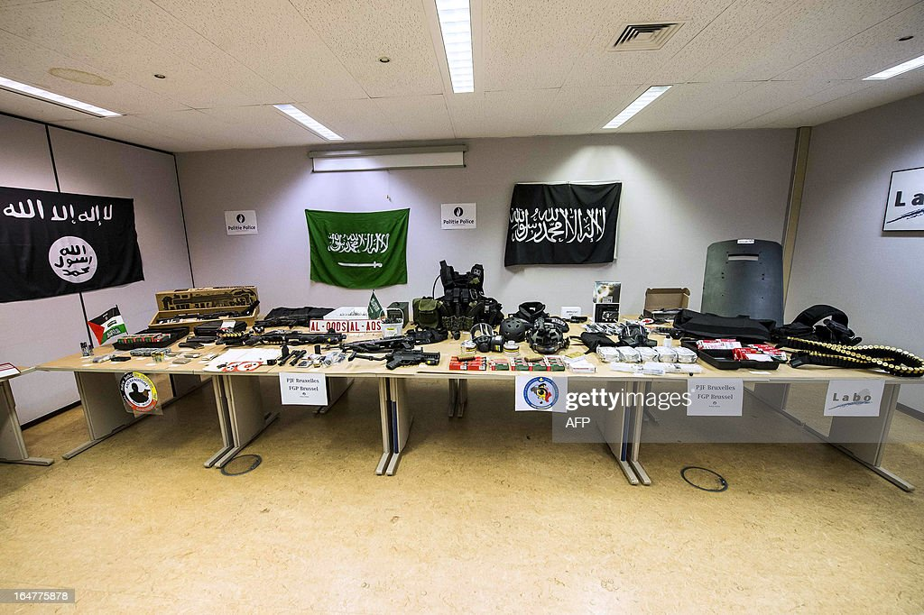 A general view taken on March 27, 2013 in Brussels shows paramilitary equipment, weapons and ammunition discovered on March 26 by the police in the Anderlecht flat of a man suspected of terrorist links. Police shot dead the man, of Algerian origin, after he opened fire on them on March 26. Officers had been investigating him following a tip-off from French authorities. They had already linked him to one recent robbery and moved in to arrest him after receiving information that he might be planning another crime.