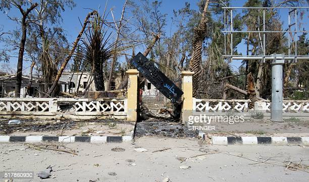 A general view taken on March 27 2016 shows a destroyed entrance to the city council of Palmyra after government forces recaptured the ancient Syrian...