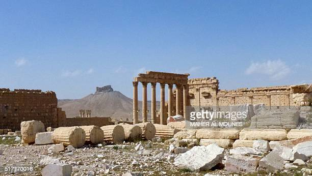 A general view taken on March 27 2016 shows part of the ancient city of Palmyra with the citadel in the background after government troops recaptured...