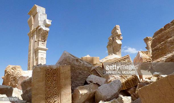 A general view taken on March 27 2016 shows part of the remains of Arch of Triumph also called the Monumental Arch of Palmyra that was destroyed by...