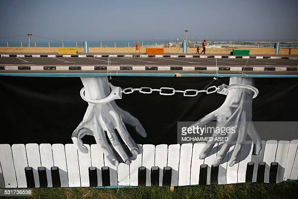TOPSHOT A general view taken on May 16 2016 shows graffiti in Gaza City commemorating the 'Nakba' or 'catastrophe' in Arabic in reference to the...