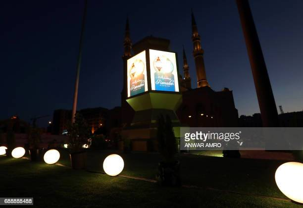 A general view taken on May 26 2016 shows a large lantern decorating the street in front of the Mohammad alAmin Mosque in downtown Beirut as Muslims...