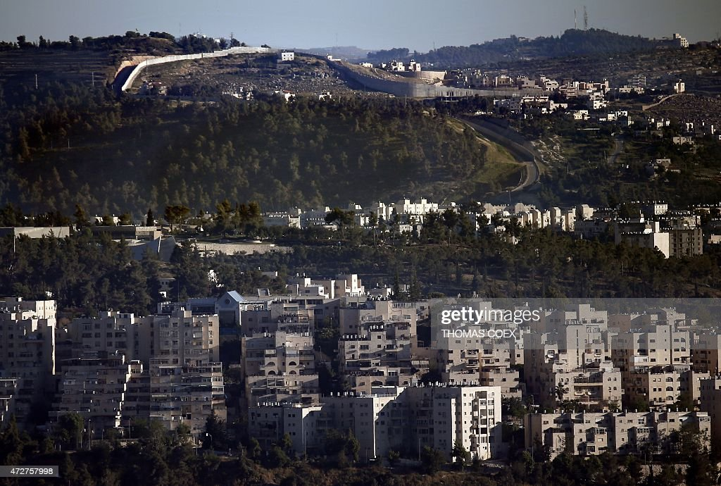 A general view taken on May 8 2015 shows Israel's controversial separation barrier which separates Jerusalem city from the West Bank city of Beit...