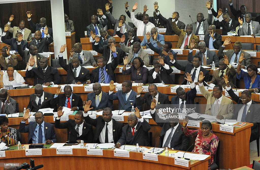 A general view taken on November 21, 2012 shows deputies voting on bills presented by the government at the parliament in Abidjan. President Alassane Ouattara on November 14 dissolved the government formed in March and charged with reviving the country after the political and military crisis of 2010-2011 due to differences among the governing parties -- Ouattara's RDR, former president Henri Konan Bedie's PDCI and the small UDPCI party. AFP PHOTO / SIA KAMBOU