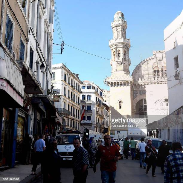 A general view taken on October 29 2014 shows people walking down a street leading to the Ketchaoua Mosque in the historical Casbah district of...