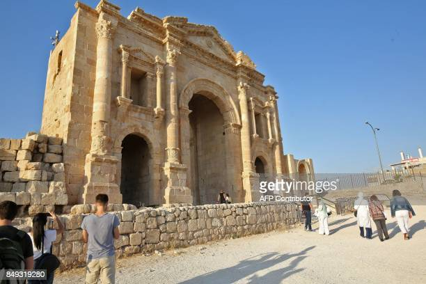 A general view taken on September 18 2017 shows tourists visiting Hadrian's Arch at the archaeological site of Jerash some 50 kilometres north of the...