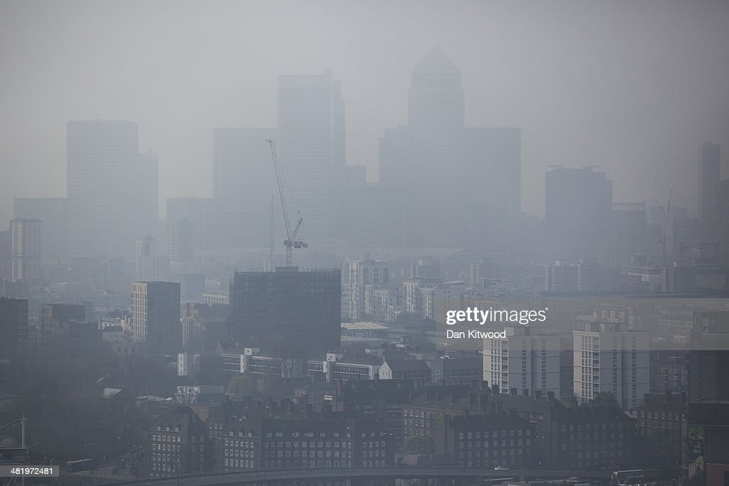 A general view through smog of the Canary Wharf financial district on April 2 2014 in London England Dust from the Sahara combined with pollution...
