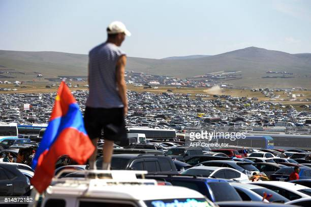 General view where people park their cars during the traditional Nadaam festival in Ulan Bator on July 12 2017 The festivities consist of a number of...